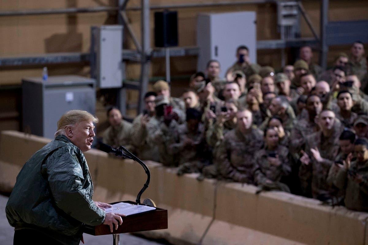 Trump visits US troops in Iraq. (AP)