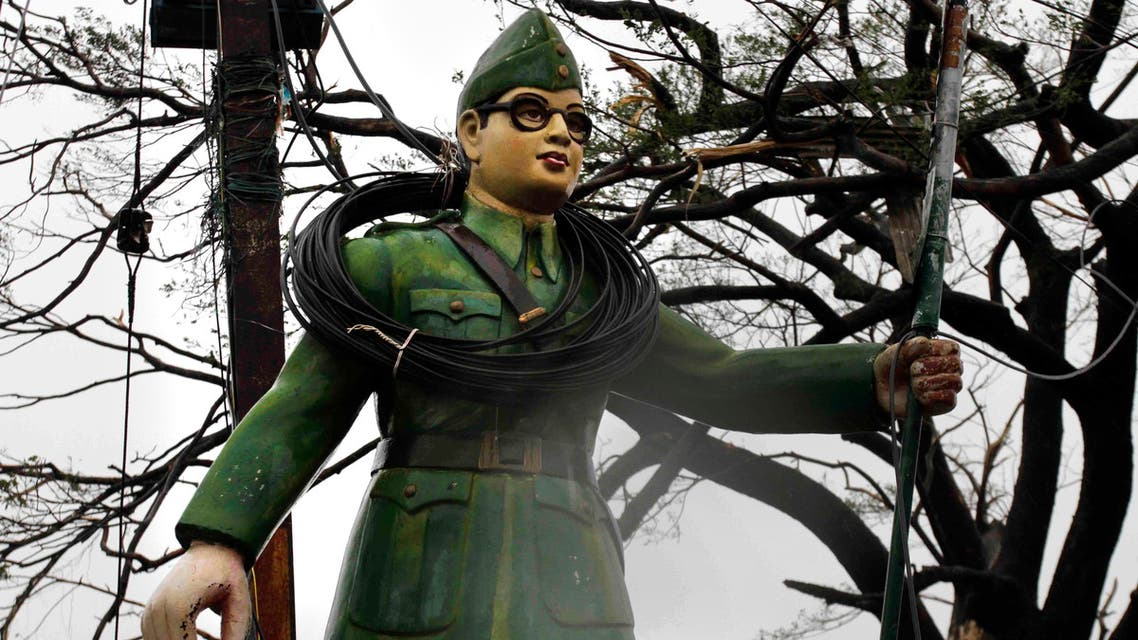 Electric wires are entangled around a statue of Subhash Chandra Bose at road crossing during Cyclone Phailin in Berhampur, India, on Oct. 13, 2013. (AP)