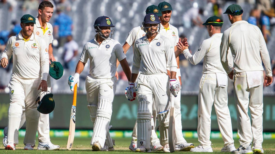 India's Rishabh Pant, center left, and Mayank Agarwal, center right, walk off the field at the end of play in Melbourne on Dec. 28, 2018. (AP)