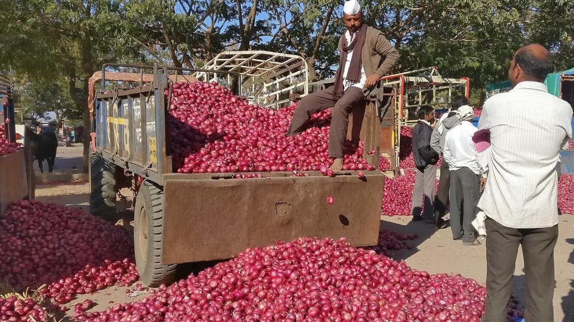 A farmer sits on a tractor trolley after auctioning his onions at Lasalgaon market in Nashik in the western state of Maharashtra on December 19, 2018. (Reuters)