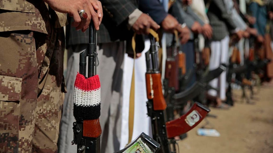 Tribesmen loyal to Houthi rebels hold up their weapons as they attend a gathering to show their support for the ongoing peace talks being held in Sweden, in Sanaa, Yemen, Thursday, Dec. 13, 2018. (AP)