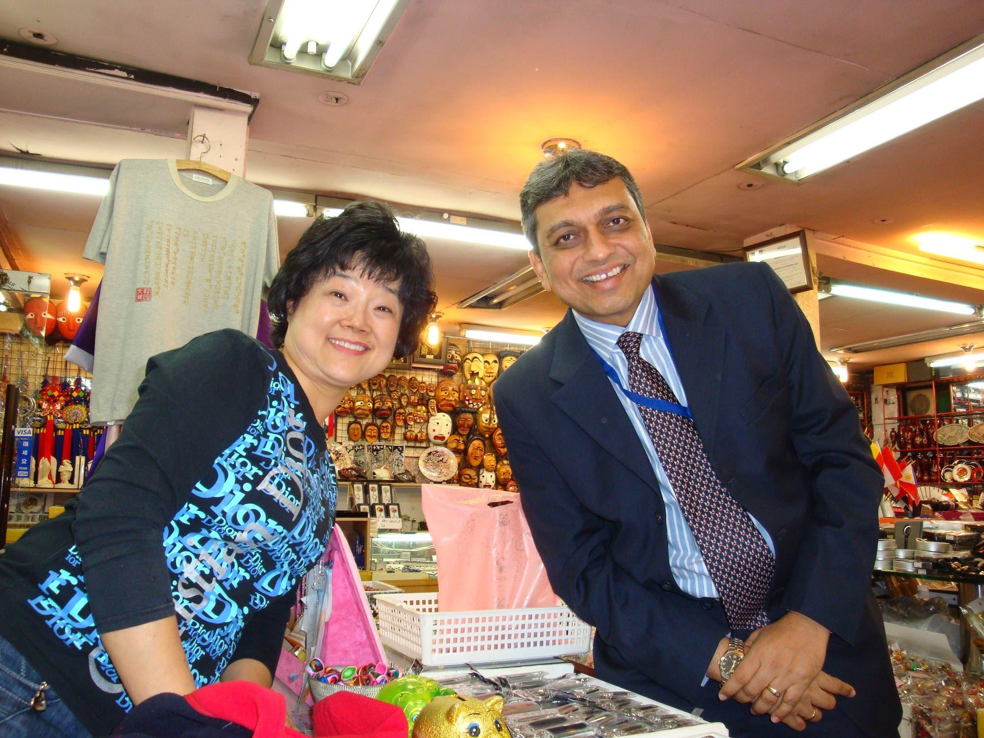 Doshi with a South Korean seller. (Supplied)