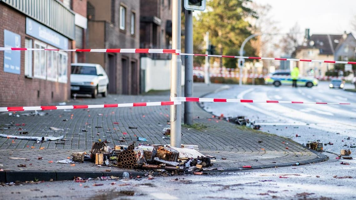 A picture taken on January 1, 2019 in Bottrop shows a cordoned off area at the site where a man injured four people after driving into a group celebrating the new year, in what police described as an anti-migrant attack. (AFP)