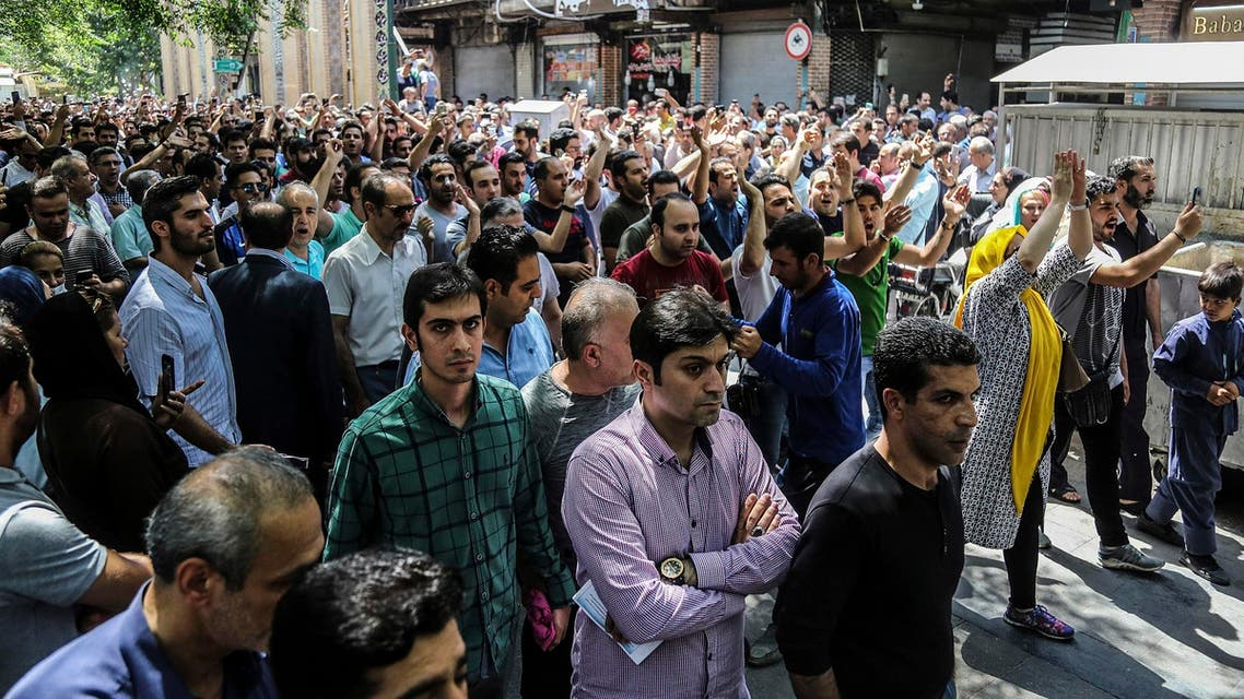 Protesters chant slogans at the old grand bazaar in Tehran on June 25, 2018. (Iranian Labor News Agency via AP)