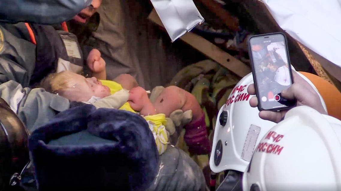 TV footage shows employees saving the 10-month-old baby in southeast of Moscow on Jan. 1, 2019. (AP)
