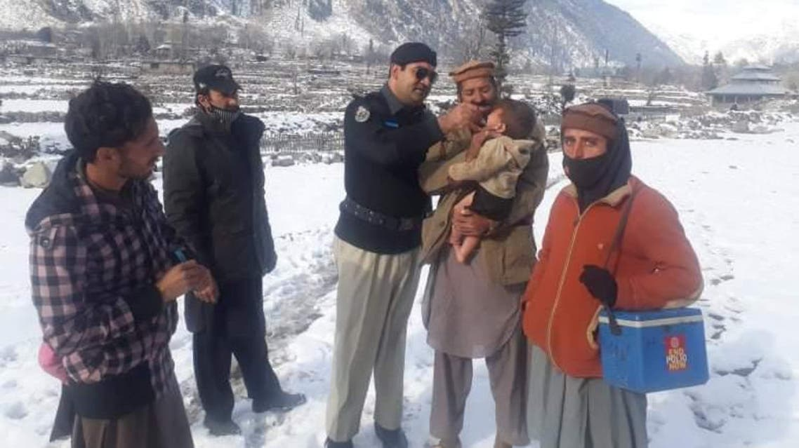 A police official administering polio drops to a child during anti-polio campaign in Upper Dir area of Pakistan. (Supplied)