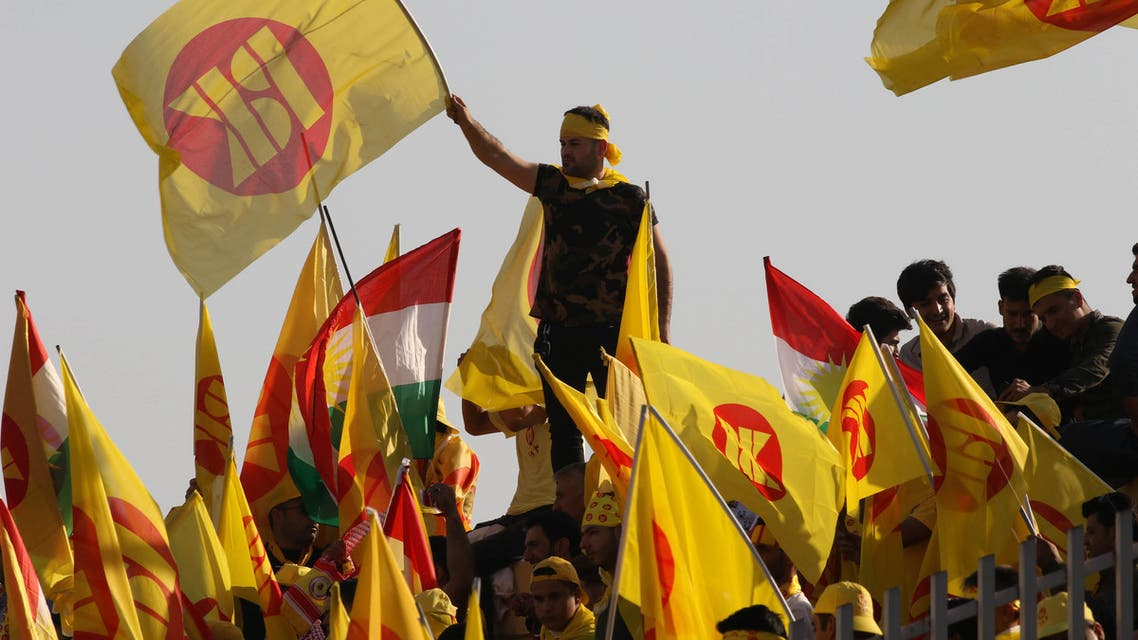 Iraqi Kurds wave flags during an election rally in Arbil on September 25, 2018. (AFP)