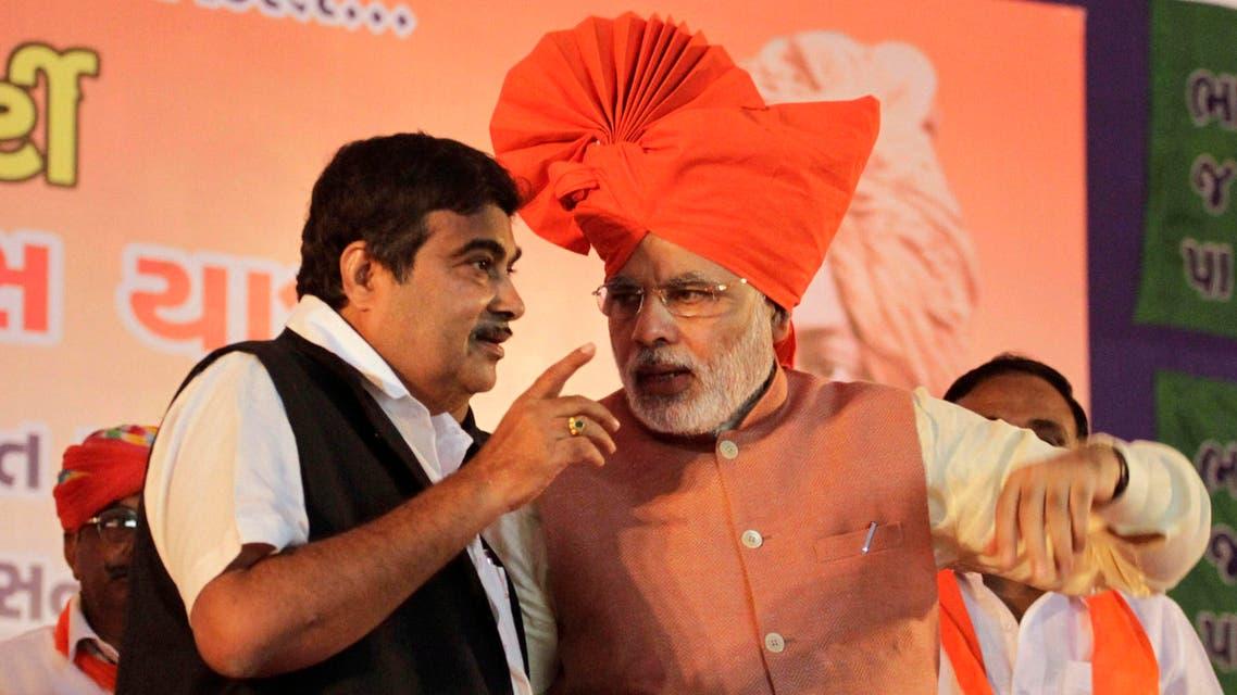 Narendra Modi with Nitin Gadkari in Ahmadabad on Sept. 17, 2012. (File photo: AP)