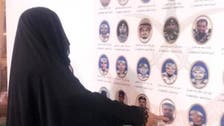 At wall of honor, Saudi martyr's mother soaks his picture in tears