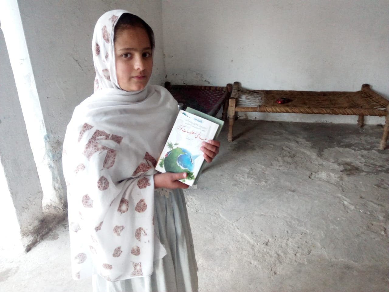 Shifa Raj helps her father in delivering library books. (Supplied)