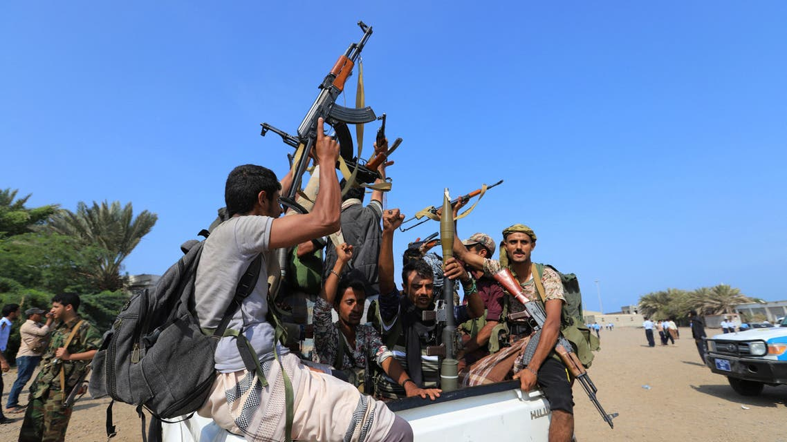 Houthi militants ride on the back of a truck as they withdraw, part of a U.N.-sponsored peace agreement signed in Sweden earlier this month, from the Red Sea city of Hodeidah