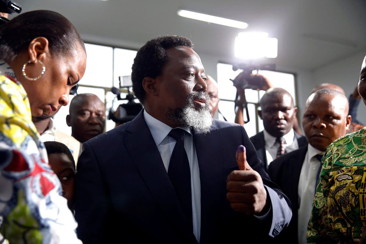Democratic Republic of Congo's President Joseph Kabila displays ink on his hand after casting his vote at a polling station in Kinshasa. (Reuters)