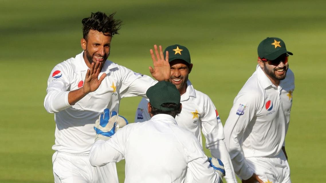 Pakistan's Shan Masood celebrates with team mates after taking the wicket of South Africa's Aiden Markram. (Reuters)