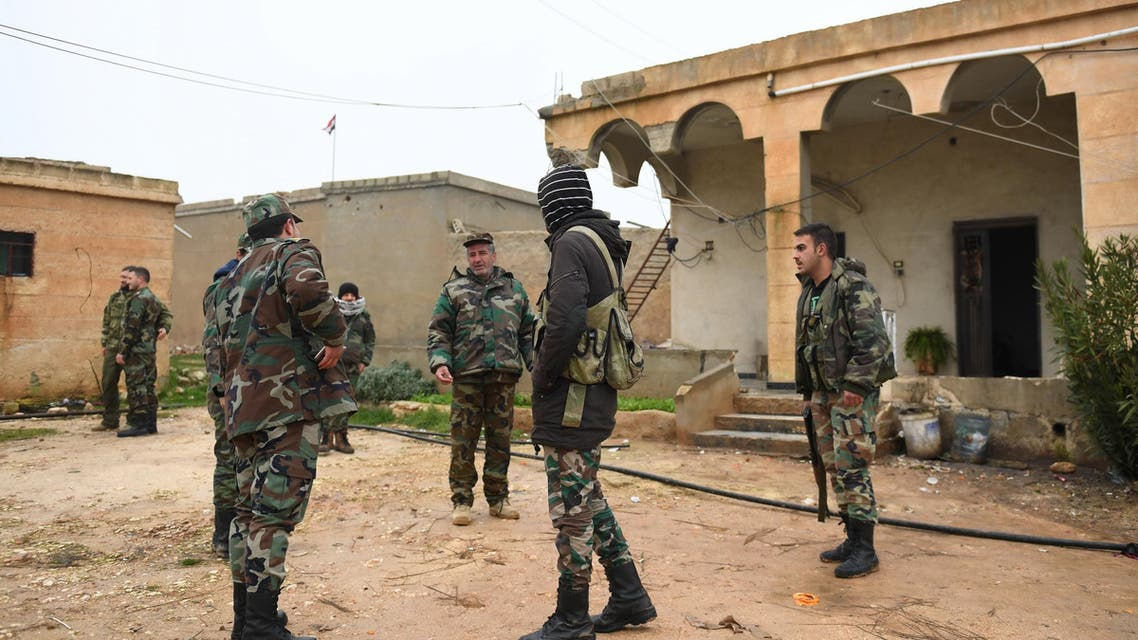 Syrian regime forces gather in the southern countryside of the northern Kurdish-controlled city of Manbij on December 30, 2018. The unexpected US pullout announcement left Syria's Kurds scrambling to find a new ally in the Damascus regime, as they feared losing US support would leave them exposed to a long-threatened Turkish assault.