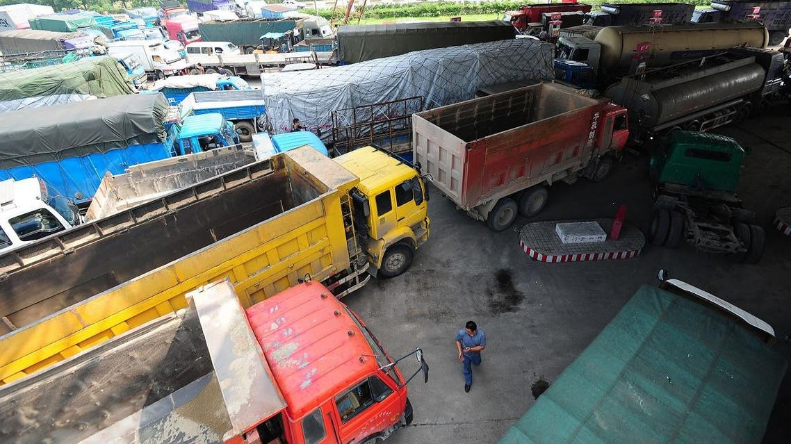A long queue of trucks wait to fill up with diesel at a petrol station in Wuhan, central China's Hubei province. (AFP)