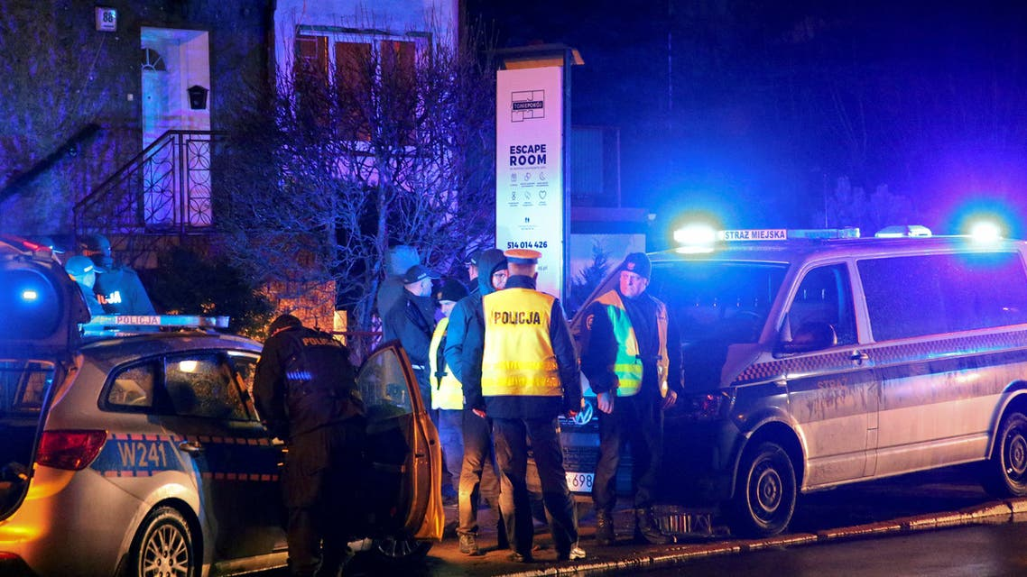 Police cars are seen at the site of a fire which broke out in an escape room in Koszalin, Poland January 4, 2019. Picture taken January 4, 2019. Agencja Gazeta/Cezary Aszkielowicz/via REUTERS ATTENTION EDITORS - THIS IMAGE WAS PROVIDED BY A THIRD PARTY. POLAND OUT. NO COMMERCIAL OR EDITORIAL SALES IN POLAND.