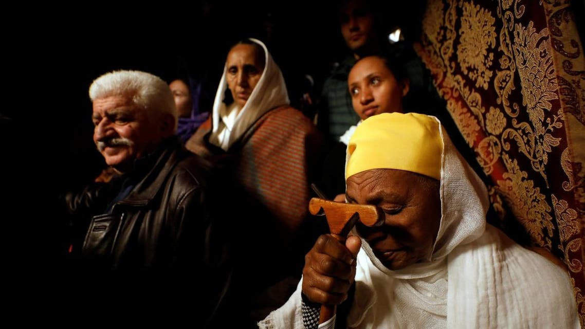 Worshippers pray inside the Church of the Nativity in Bethlehem, in the Israeli-occupied West Bank. (Reuters)