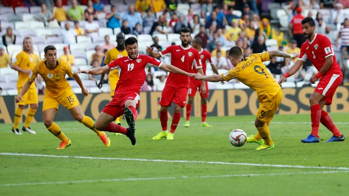 Australia's forward Jamie Maclaren, second right, attempts a shoot past Jordan's defender Anas Bani Yaseen, second left, during the AFC Asian Cup group B match. (AP)
