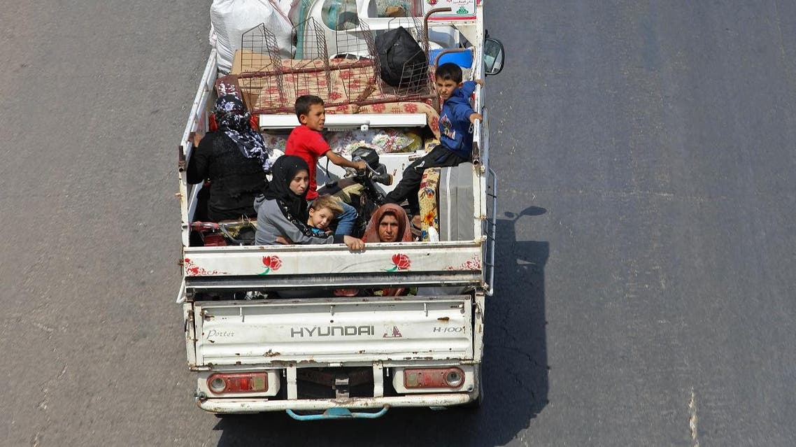 Residents of the Idlib province flee toward the Syrian Turkish border on September 10, 2018. (AFP)