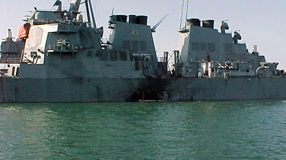 File photo taken Oct. 12, 2000 shows the port side of the USS Cole damaged after a bomb exploded during a refueling operation in Aden. (AFP)