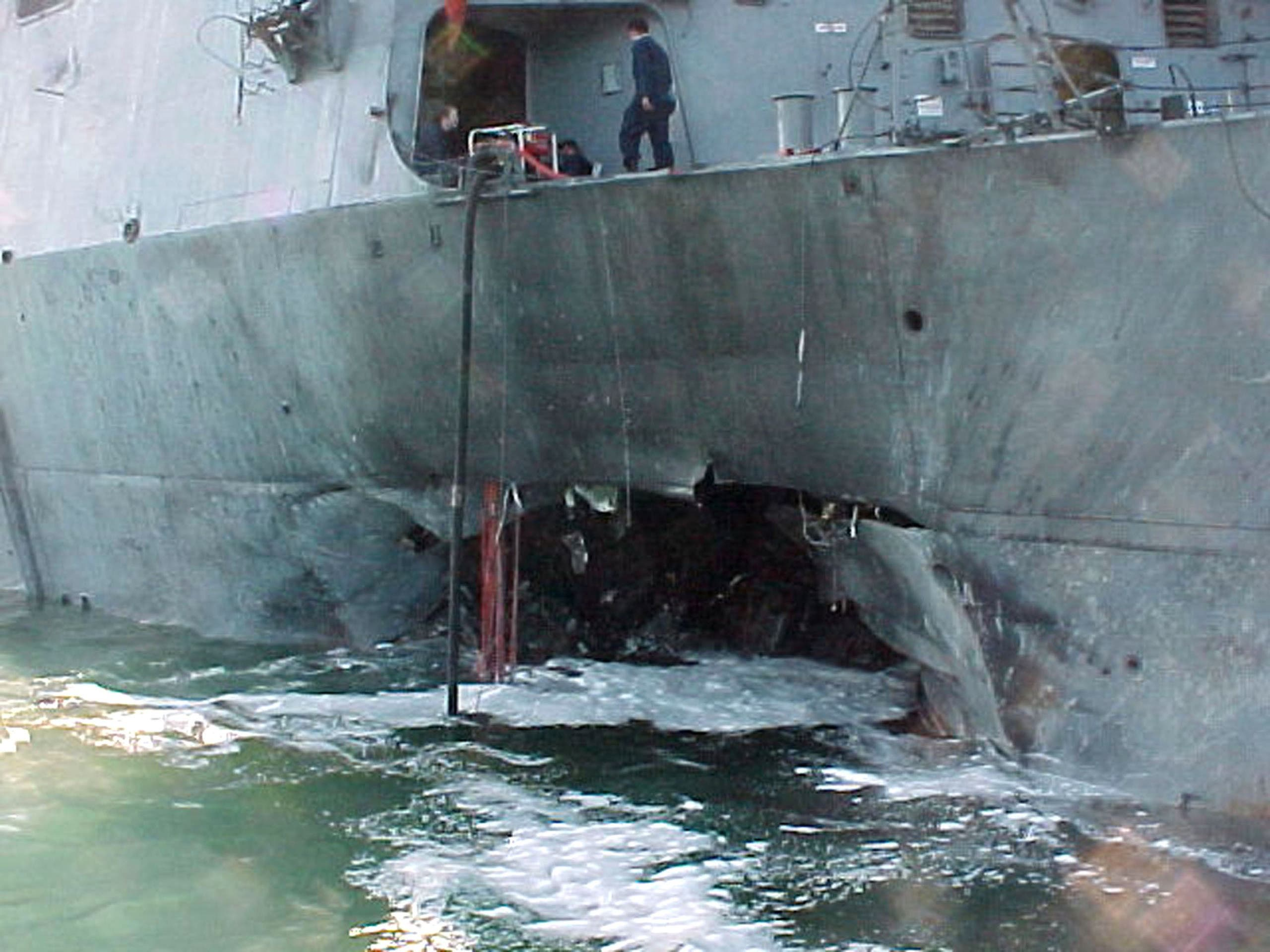 This Handout file photo taken October 12, 2000 shows the port side of the guided missile destroyer USS Cole damaged after a suspected terrorist bomb exploded during a refueling operation in the port of Aden in Yemen. (AFP)