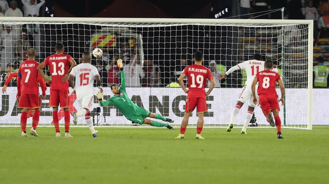 UAE's Ahmed Khalil (2nd-R) scores a penalty during opening game against Bahrain in Abu Dhabi. (AFP)