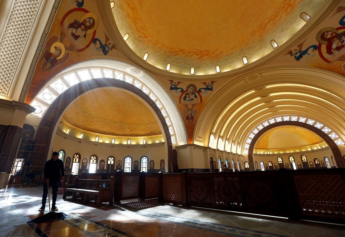 A worker cleans the interior of the new Coptic Cathedral of the Nativity at the New Administrative Capital (NAC) east of Cairo. (Reuters)