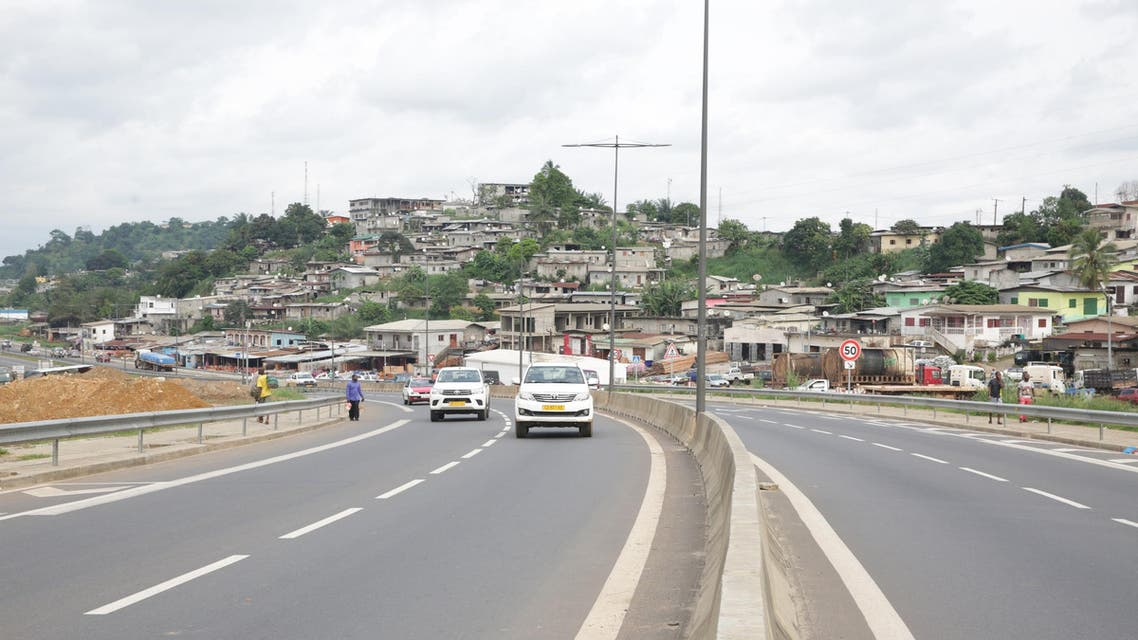 """Cars drive on a new section of the """"Route Nationale 1"""", N1 road at the PK12 district of Libreville in Gabon on December 2, 2018. (AFP)"""