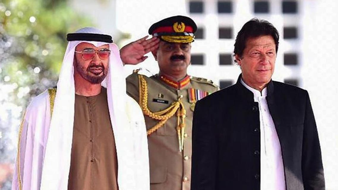 Abu Dhabi's Crown Prince Sheikh Mohamed bin Zayed Al-Nahyan (2L) attends a welcoming ceremony next to Pakistani Prime Minister Imran Khan (R) at the Prime Minister House in Islamabad. (AFP)