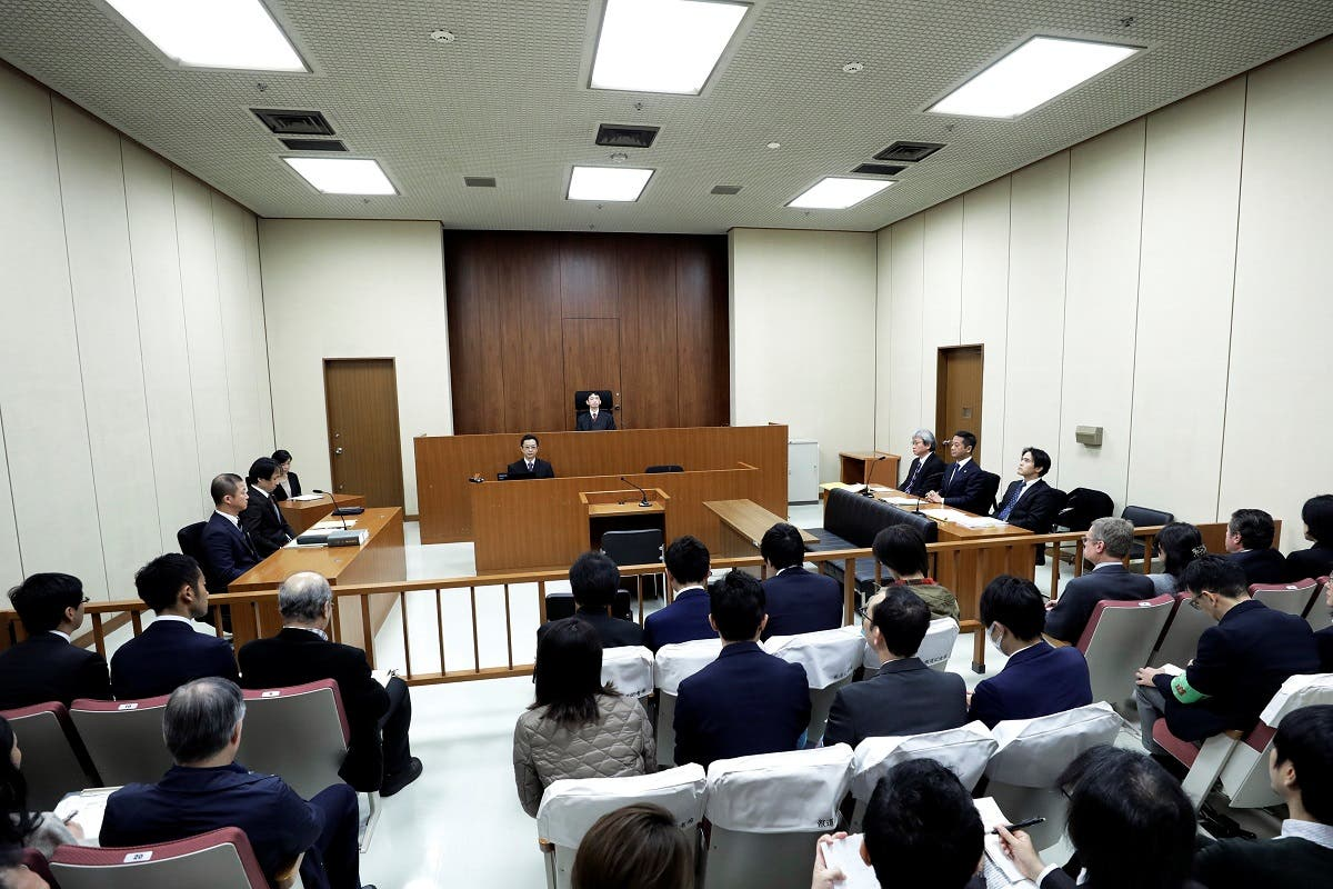 Judge Yuichi Tada and spectators sit in a courtroom ahead of a court hearing on a case of ousted Nissan Motor Co. Chairman Carlos Ghosn at the Tokyo District Court in Tokyo. (Reuters)