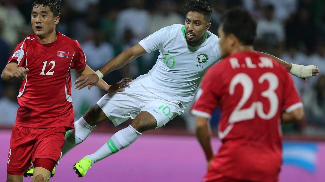Saudi midfielder Salem al Dawsari (right), shoots to score his side's third goal during the AFC Asian Cup group E soccer match against North Korea  in Dubai on January 8, 2019. (AP)