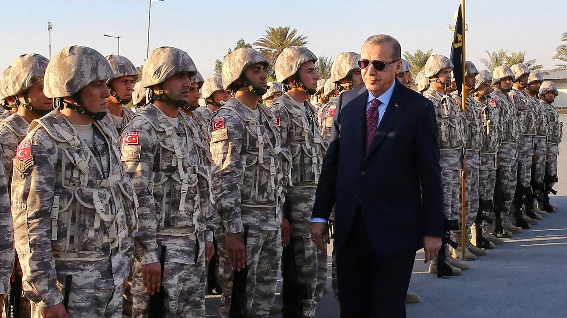 Turkey's President Recep Tayyip Erdogan, right, visits Turkish Armed Forces's soldiers, during his visit at the Qatari-Turkish Armed Forces Land Command Base in Doha, Qatar. (File photo: AFP)