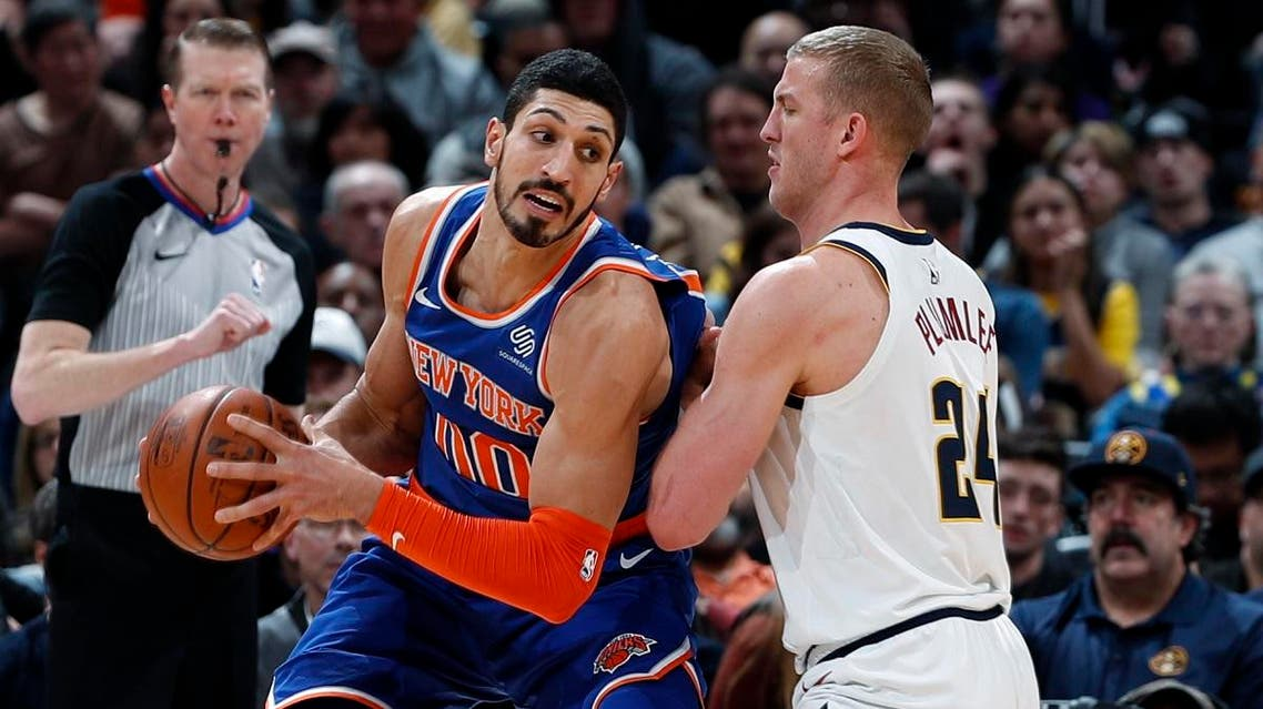 New York Knicks center Enes Kanter, left, is defended by Denver Nuggets forward Mason Plumlee during the second half of an NBA basketball game. (File photo: AP)