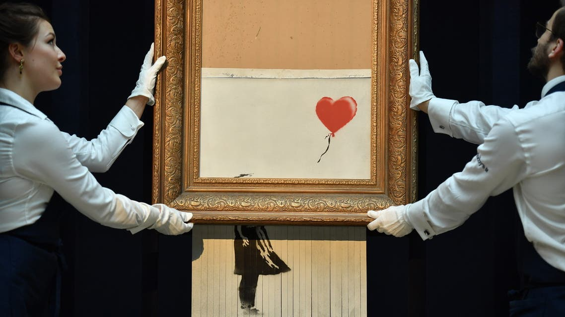 A partially destroyed Banksy canvas