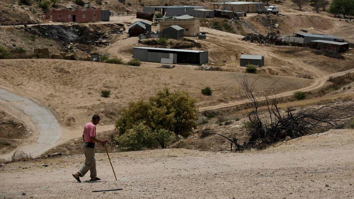 In this May 12, 2015 file photo, a Bedouin man walks through the village of Umm Al-Hiran in the Israeli Negev desert. (AP)