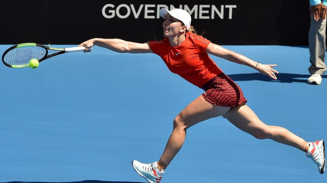 Simona Halep of Romania hits a return against Australia's Ashleigh Barty during their women's singles second round match at the Sydney International. (AFP)
