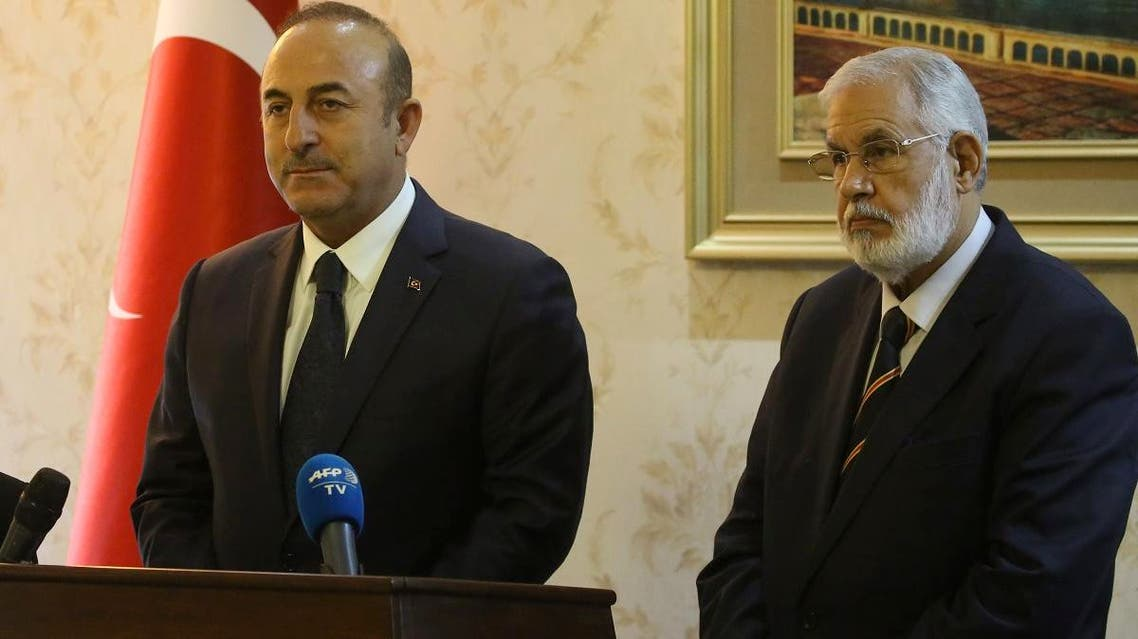 Libyan Foreign Minister Mohamed Taher Siala (L) and his Turkish counterpart Mevlut Cavusoglu (R) take part in a press conference at Mitiga International Airport near the Libyan capital Tripoli, on December 22, 2018. (AFP)