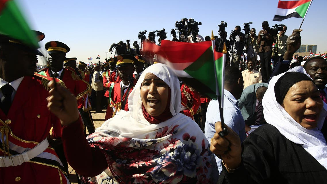 Supporters of Sudan's President Omar al-Bashir wave Sudanese flags during a rally for him in Khartoum on January 9, 2019. (AFP)