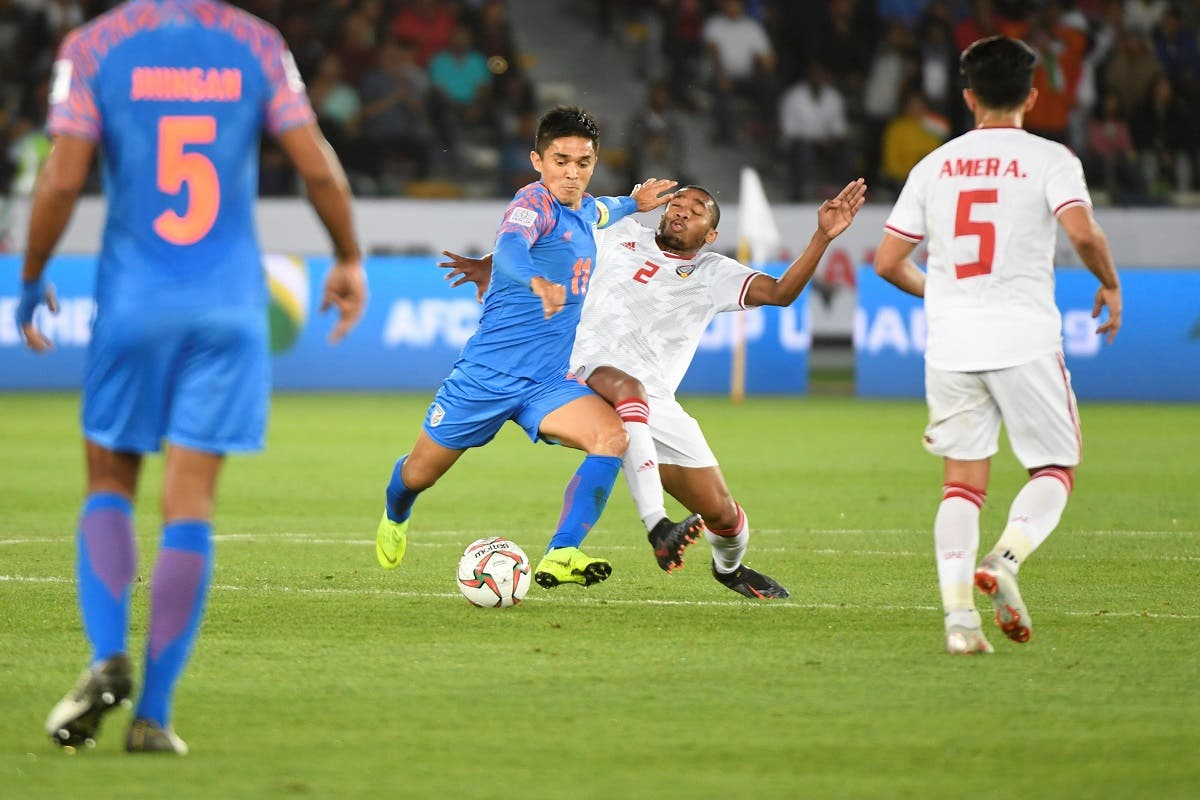 India's forward Sunil Chhetri (C-L) vies for the ball with UAE's midfielder Ali Salmeen during the 2019 AFC Asian Cup group A football in Abu Dhabi. (AFP)