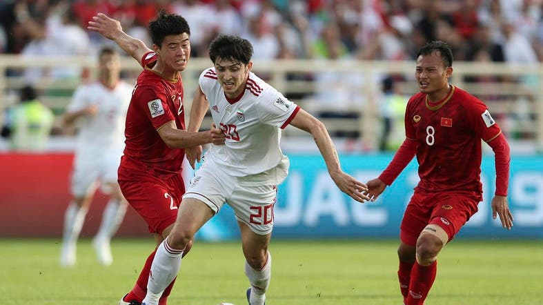 1c54366c0 ... Azmoun (C) runs with the ball to scores his side s second goal during  the AFC Asian Cup group D soccer match against Vietnam on Saturday