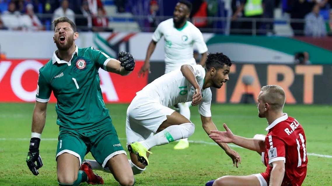 Lebanon's goalkeeper Mehdi Khalil (left), reacts after Saudi midfielder Hussain al-Mogahwi, (center), score his goal during the AFC Asian Cup group E match  on January 12, 2019. (AP)