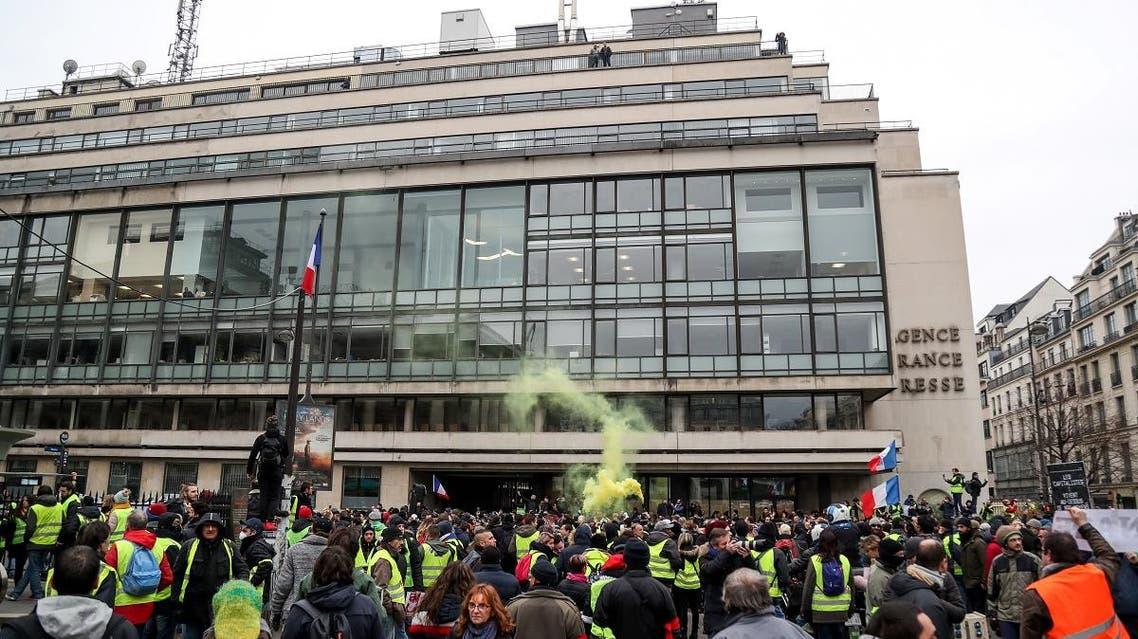 Yellow vest protestors gather outside AFP HQ in Paris (AFP)