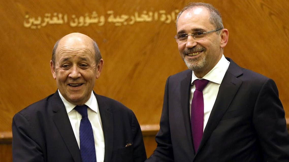 Jordanian Foreign Minister Ayman Safadi and France FM (AFP)