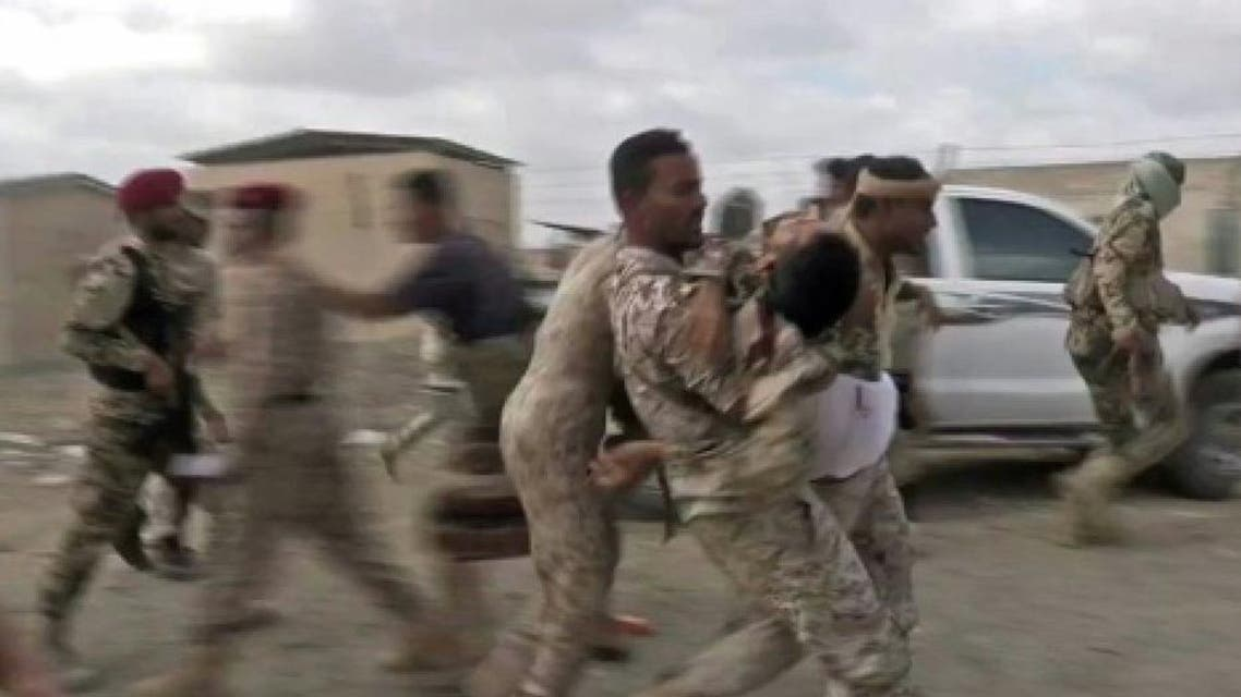 An image grab taken from a video obtained by AFPTV shows a wounded Yemeni soldier being carried by comrades after a rebel drone strike hit Al-Anad air base in Yemen's government-held southern Lahj province on January 10, 2019 An image grab taken from a video obtained by AFPTV shows a wounded Yemeni soldier being carried by comrades after a rebel drone strike hit Al-Anad air base in Yemen's government-held southern Lahj province on January 10, 2019 AFP
