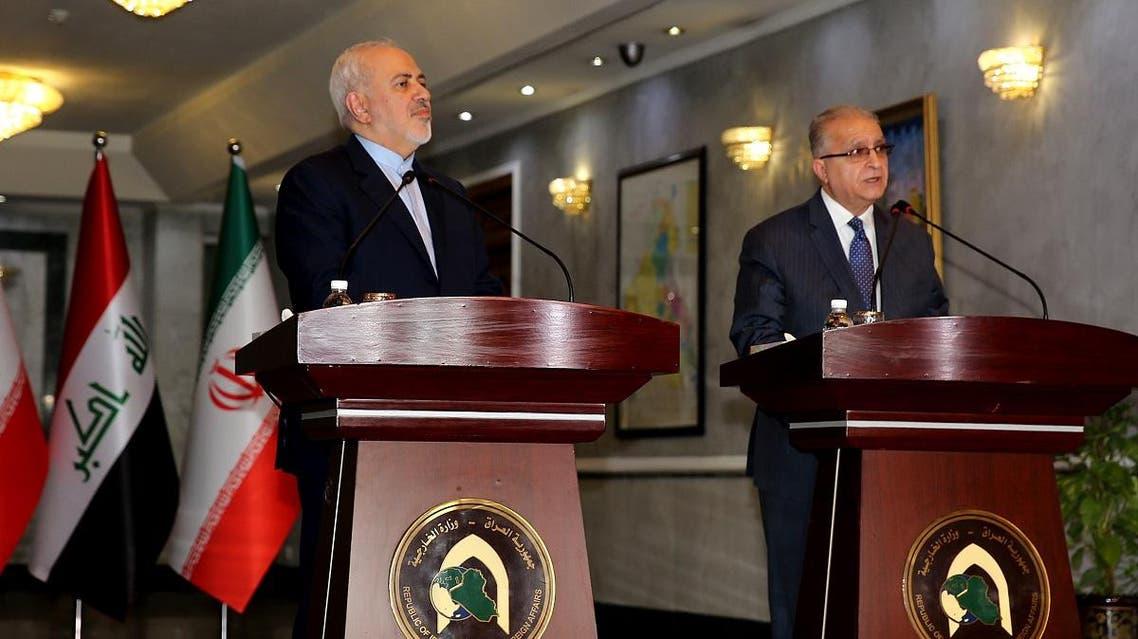 Iran's Zarif and Iraq's al-Hakim (AFP)
