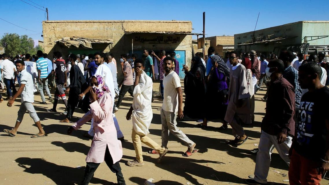 Sudanese demonstrators march along the street during anti-government protests after Friday prayers in Khartoum. (Reuters)