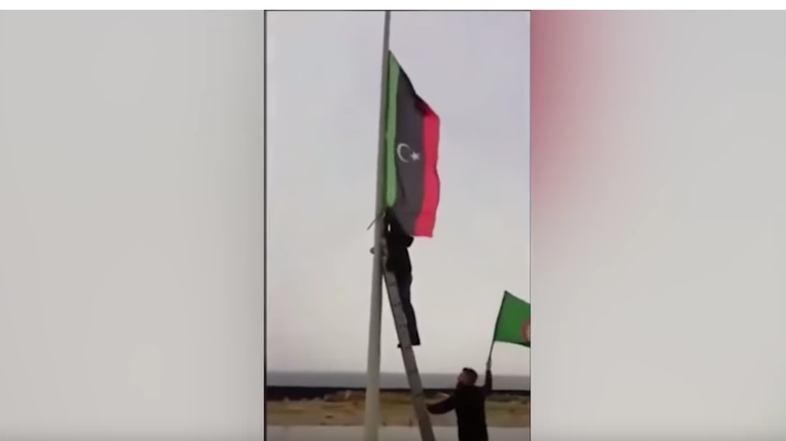 Libyan flag removal by Amal Movement in Lebanon - YouTube screen grab