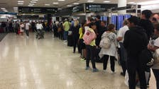 Travelers fume in long lines at Miami airport in government shutdown