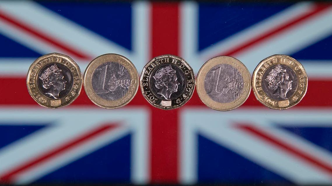 British one pound sterling coins and one Euro coins are arranged in front of a Union flag for a photograph in London on December 14, 2017.  Justin TALLIS / AFP