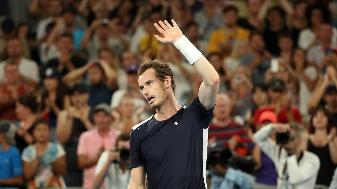 Britain's Andy Murray looks dejected after loosing the match against Spain's Roberto Bautista Agut. (Reuters)